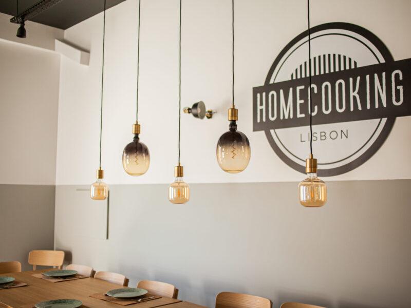 Homecooking Lisbon logo and table